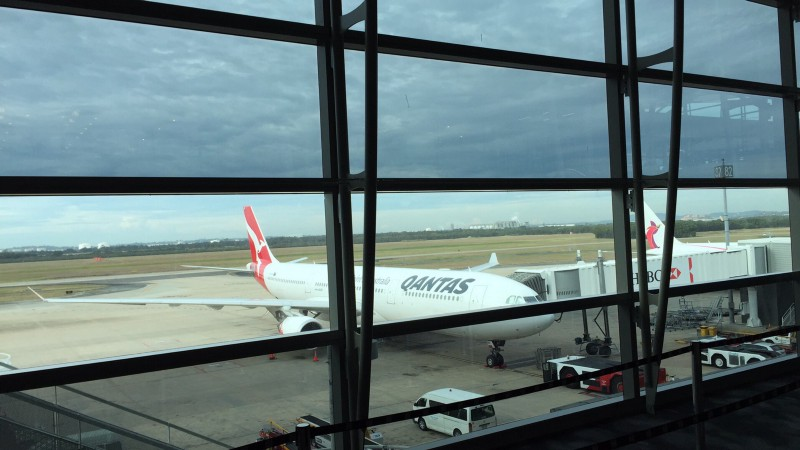 Qantas airplane parked at the airport gate