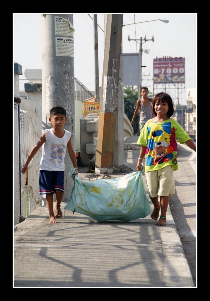 Kids delivering scavenged metal