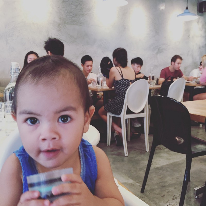 Our toddler son having brunch a Stranger's Reunion, Singapore